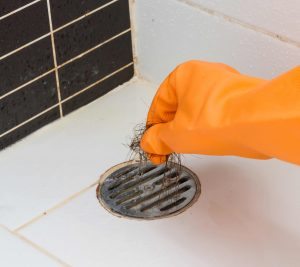 clogged shower drain with hair